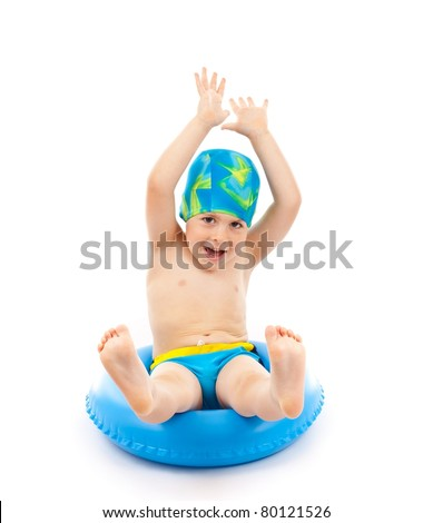 Funny little boy playing with blue life ring in swim caps, isolated in white