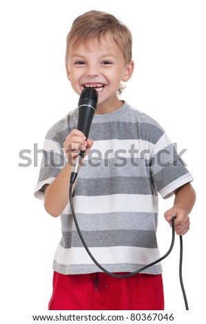 Funny little boy singing with a microphone isolated on white background - stock photo