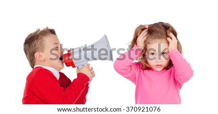 Funny little boy talking to his sister through a megaphone. Isolated on white background - stock photo