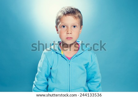 Funny Little Boy with Blue Eyes - stock photo