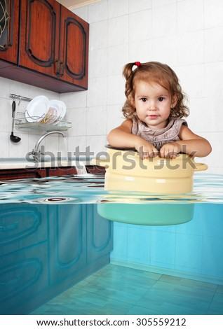 Funny little child swim in pan in the flooded kitchen, mess creative concept - stock photo