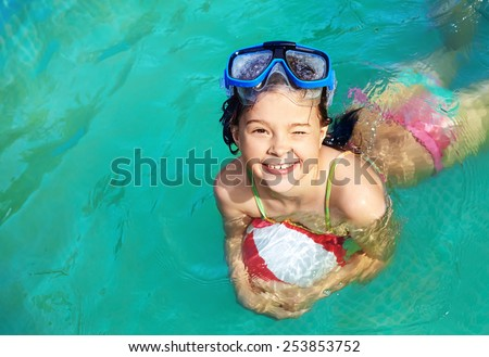 funny little girl in swimming pool. children outdoors - stock photo