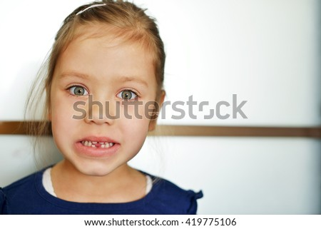 funny little girl lost her first tooth