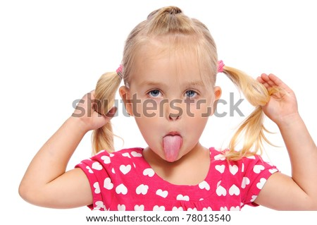 funny little girl makes a silly face while pulling on her pigtails - stock photo