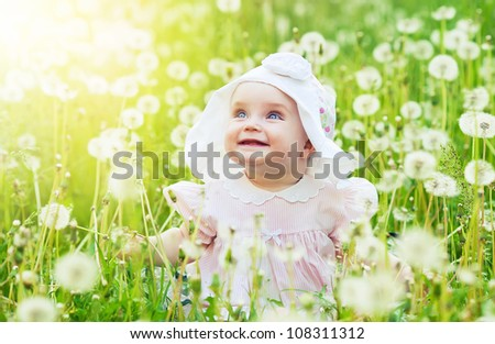 funny little girl on the field - stock photo
