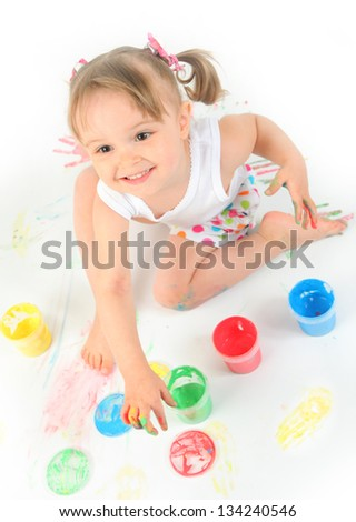 funny little girl painting on white