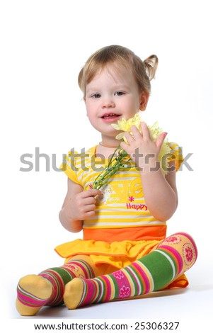funny little girl relaxing with yellow flowers