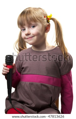 Funny little girl singing with microphone isolated over white background - stock photo