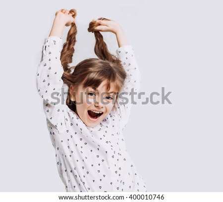 Funny little girl with arms up - stock photo