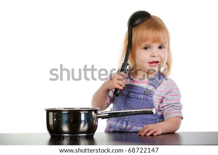 funny little girl with the scoop on the head - stock photo
