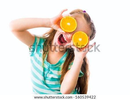 funny little girl with two halves of oranges isolated on white background - stock photo