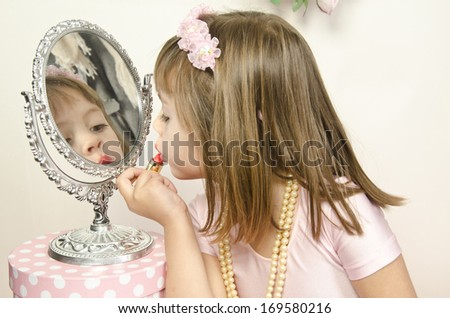 Funny little princess girl in silver crown and pink dress over white - stock photo
