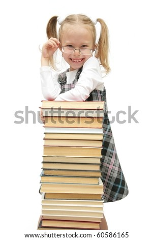 funny little schoolgirl with books studio shot on white - stock photo
