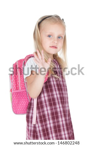 Funny little schoolgirl with pink backpack over white