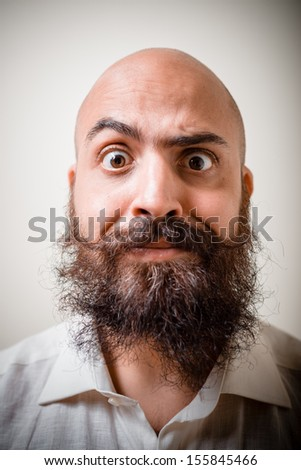 funny long beard and mustache man with white shirt on gray background - stock photo