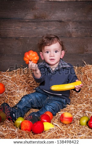 funny lovely baby boy little child in trendy jeans on hay. happy  kid playing game. Cute adorable child baby American boy. Beautiful expressive laughing smiling baby infant toddler