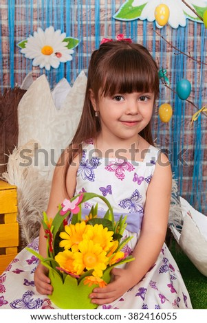 Funny lovely baby little child easter stock photo royalty free funny lovely baby little child in easter basket with eggs cute little girl holding flowers negle Image collections