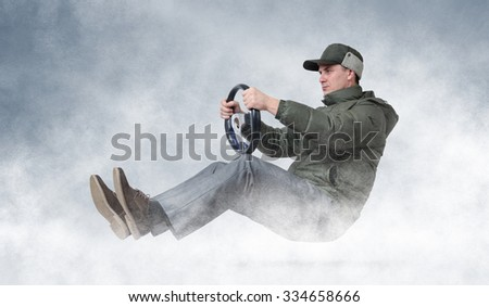 Funny man driving a car in winter, winter driving concept - stock photo