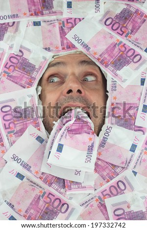funny man, eating euro notes, financial concept - stock photo