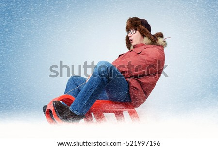 Funny man fly on a sled in the snow, concept winter fun