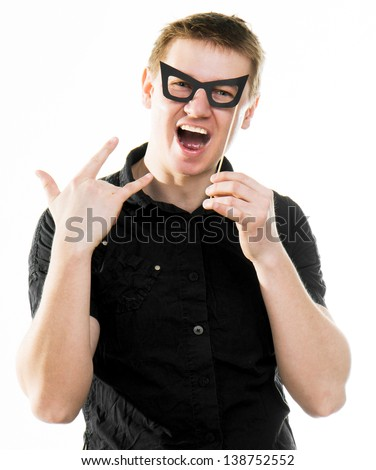 funny man in fake glasses with Rock and roll sign isolated on a white background - stock photo