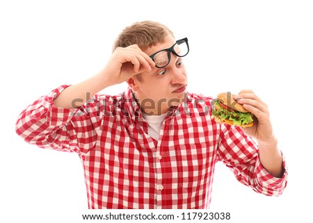 Funny man in glasses looking at hamburger isolated on a white