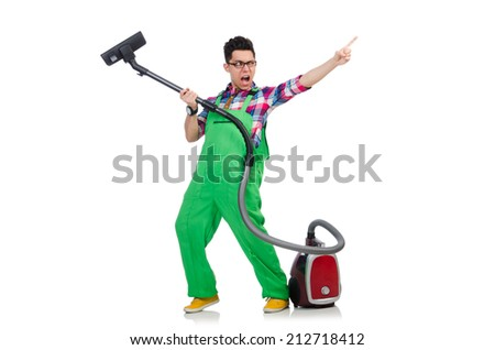 Funny man in green coveralls vacuum cleaning - stock photo