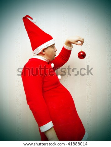 Funny man in red Santa Claus costume