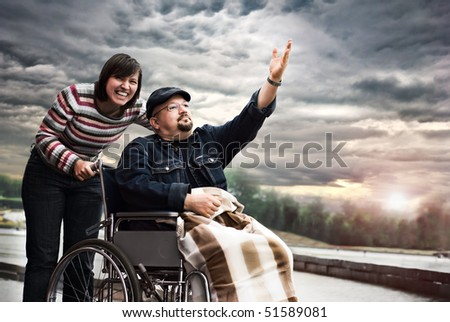 Funny man on a wheelchair - stock photo
