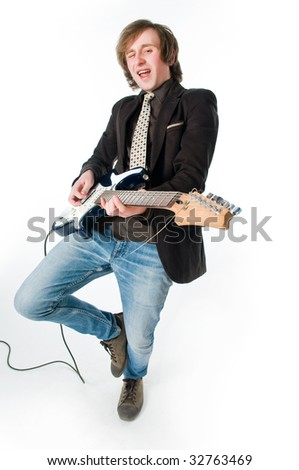Funny man playing electro guitar, high angle view - stock photo