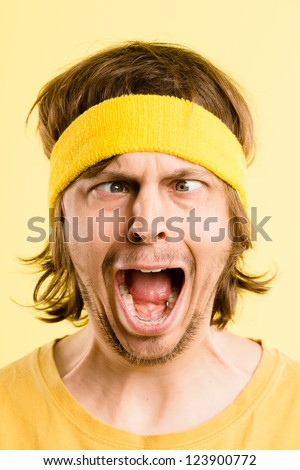 funny man portrait face crazy real people high definition yellow background - stock photo