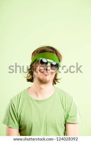 funny man portrait real people high definition green background - stock photo