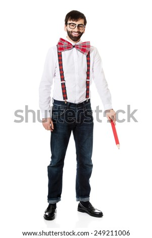 Funny man wearing suspenders pointing down with big pencil. - stock photo