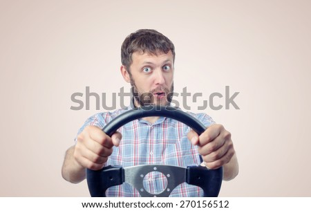 Funny man with a steering wheel, car drive concept
