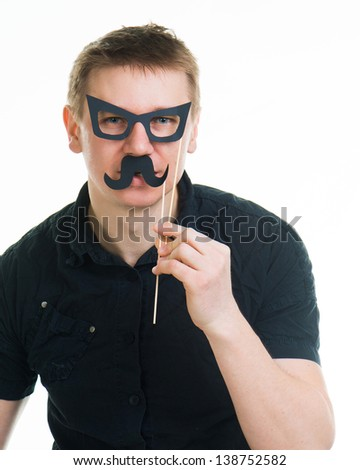 funny man with fake glasses and a mustache isolated on a white background - stock photo
