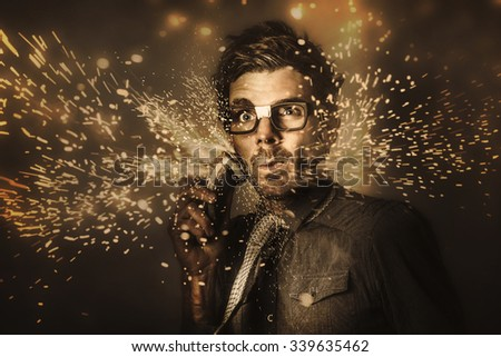 Funny mens personal grooming concept on the face of a fashion man having a shave with electric beard trimmer in a grind of razor sharp sparks. Too hard for skincare products - stock photo