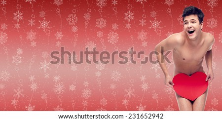funny naked laughing man holding heart over winter snowflakes background - stock photo