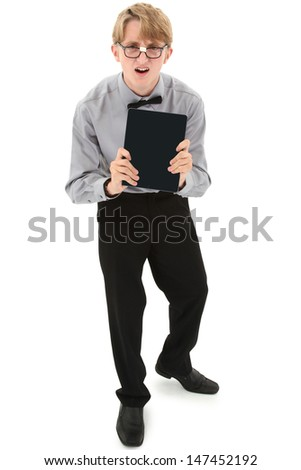 Funny nerd teen boy with touchscreen laptop over white with clipping path. - stock photo