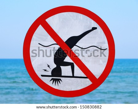 Funny no diving (shallow water) sign on sea background - stock photo