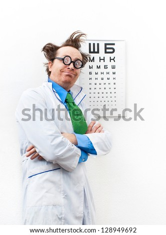 Funny oculist in the white coat - stock photo