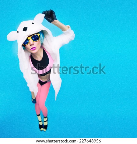 Funny Party girl in hoodie bear on a blue background. Bright Winter fashion  time - stock photo