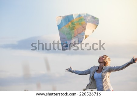 Funny Photo of a Young Lost Woman Losing a Map Because of the Wind - stock photo