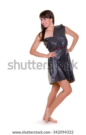 Funny photo of a young woman with nothing to wear but waste materials - this is part of a series with jute bag, toilet paper, bubble wrap etc - stock photo