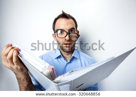 Funny photo of businessman with beard wearing shirt and glasses. Surprised businessman looking at camera with eyes wide open and holding folder full of documents. Isolated on white background - stock photo