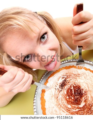Funny picture of a overweight woman eating sweet cream cake. - stock photo