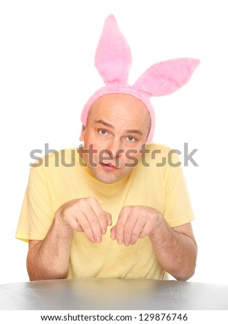 Funny picture of an happy man with pink rabbit ears. Happy easter concept. - stock photo