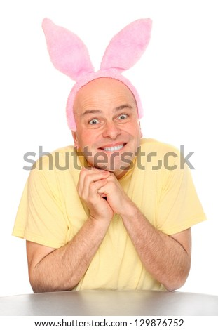 Funny picture of an happy man with pink rabbit ears. Happy easter concept.