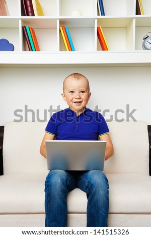 funny picture of big baby with laptop - stock photo