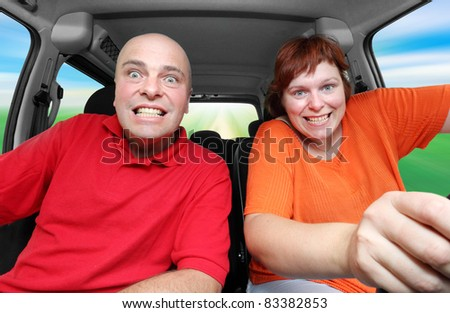 Funny picture of crazy family riding on a holiday. - stock photo