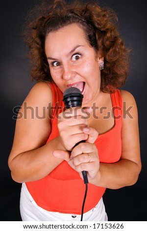 funny picture of singing woman - stock photo